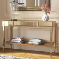 A chic spot to set down mail, magazines, and more, this mirrored console table brings both function and fashion to your living room or entryway. Crafted with a metal frame, this clean-lined design sports a sleek metallic finish with beveled glass panels for a glamorous look. One drawer provides out-of-sight storage for a few odds and ends, while the rectangular top and open lower tier provide plenty of space to show off framed photos, lovely lamps, and beyond. Assembly is required.