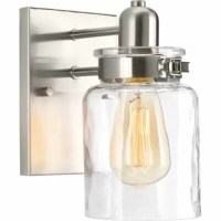 From brightening up your covered porch to bouncing light around your bathroom vanity, this sconce offers style and versatility to almost any room in your home. Featuring a clear glass shade and metal backplate with a silver finish, it fits in any contemporary or classic setting. It can be installed in either an upward or downward direction to suit your needs, and it is compatible with a dimmer so you can find the perfect ambiance wherever you set it. Accommodates one 100 W E26 incandescent...