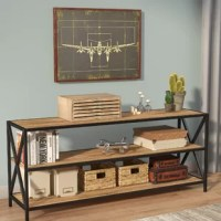 Whether it's placed in the entryway, home office or master suite, the TV stand is a versatile piece of furniture that provides space to stash and store while lending visual appeal to any ensemble. This design sets the tone for an industrial-inspired style with its cross-shaped openwork frame and crisp, clean silhouette. Crafted from metal and high-grade manufactured wood, it features three shelves perfect for tucking away accessories in the foyer or displaying potted plants and family photos...