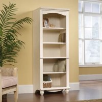 An ideal addition to any den or home office, this bookcase lets you display decor and keep favorite reads on hand. Crafted from solid manufactured wood, its frame strikes a silhouette with a traditional design, beadboard inspired back, and two turned feet. Five shelves (four adjustable) sit in the center, perfect for hosting your novel collection, or a few framed family photos and decorative objects.