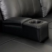 This is the perfect accessory for those who purchase theater seats with either a middle love seat or sofa layout. Its slim profile supports your arms with its plush padding, yet it doesn't take up much room so you still have ample space to sit in complete comfort. The storage compartment is easily accessible and holds remote controls and other small items. The removable arm simply slides in between two seat cushions, fitting snugly into position. The bottom of the arm has a fin like wood...