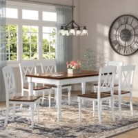 Whether hosting a dinner party with close friends or simply enjoying an everyday meal with the family, this seven-piece dining set is a must-have for your home. Crafted from a blend of solid and manufactured wood, the rectangular table showcases four turned legs and boasts a neutral two-tone finish. Plus, it includes an extendable table leaf mechanism to accommodate additional dinner guests. Six matching chairs sport an open back and contoured seat for added comfort.