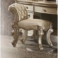 Create an elegant, traditional design in your bedroom with this Vanity Stool. A hand-crafted piece inspired from the luxurious designs of the past, this product features elaborate wood carving details, traditional hardware and a sophisticated style.