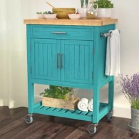 Lovely addition to any kitchen, this cart provides a space to set up your place, essential storage space to tuck away kitchen supplies, and a pop of coastal charm. The clean-lined frame is crafted from pine wood with beadboard detailing and it is topped with a thick butcher block. The bottom shelf showcases a slatted plank design, and the four feet have caster wheels so you can easily move it from place to place.