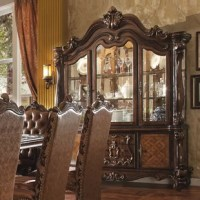 Irresistibly inviting, this Welton Lighted China Cabinet displays the unrivaled beauty of the traditional dining. Highly decorative base with oversized scrolled feet adds classic character and represents luxurious detailing.