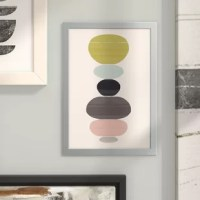 Inspired by our favorite yoga class and our quest to achieve blissful balance, this vivid graphic art print showcases a stack of colorful circles piled in perfect harmony. This artsy image is printed on cotton canvas, then professionally hand-stretched and gallery-wrapped over a premium frame in a stark white finish and comes ready to hang. Establish a curated aesthetic in your dining room by rolling out a vibrant overdyed area rug in the center of the space, then arrange painted metal cafe...