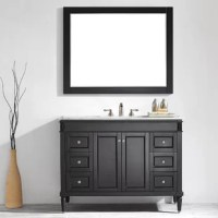 Refresh and update your bathroom, with a new vanity set. The single vanity set is crafted of solid oak wood and wood veneers, with a Carrara white marble top, and features an undermount rectangular ceramic sink. It includes one cabinet, and four drawers for concealed storage of crisp towels, cleaning supplies, and more. A mirror is also included with this piece! This vanity base measures 35.9'' H x 48'' W x 22'' D, with a 8