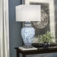 """A contemporary update on a traditional design staple, this ornate 29.5"""" table lamp lends your space timeless style with a twist. Made from fine ceramic in delicate blue and white chinoiserie glaze, this elegant design showcases a classic urn-shaped body on a transparent acrylic cube base, echoed by its angular cube shade. Establish a warm, inviting aesthetic in your open concept living room by rolling out a rich damask area rug to define the space, then set a polished mahogany console table..."""