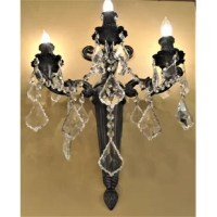 This stunning 3-light wall sconce only uses the best quality material and workmanship ensuring a beautiful heirloom quality piece. Featuring a radiant flemish brass finish and finely cut premium grade clear crystals with a lead content of 30%, this elegant wall sconce will give any room sparkle and glamour.