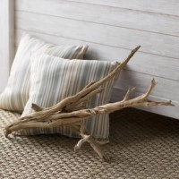 Add an airy accent to any arrangement with this decorative driftwood branch. Awash with natural charm, it's made from sanded branches found in California that are shaped over time by the local climate and elements, so no two designs are alike. Though it's on-trend sitting on a shelf or mantel on its own, this versatile piece is also perfectly paired with plants, vases, or candles for a cohesive rustic or coastal display.