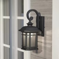 Originally made to provide people with a source of light, lanterns were first designed for function, not fashion. Today, they incorporate both. Take this one for example: Crafted from metal, it features one scrolled arm and a turned finial, putting a contemporary twist on a classic design. Panes of frosted glass diffuse light from the included medium-base bulb, while a wet location rating makes it ideal for your outdoor ensemble.