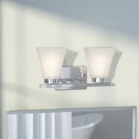Whether you're lighting up your new downtown loft or looking to lend a simply chic twist to the guest bathroom, this understated vanity light brings a subtly stylish touch to your look. Featuring two LED lights nested in a pair of satin etched glass bell shades, this vanity light brings a warm glow to your ensemble, while its clean-lined steel base makes it a sleek addition to your environment. Station it above a frameless rectangular wall mirror in the master bathroom to put a spotlight on...