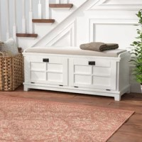 With its clean lines and understated style, this wood storage bench brings a versatile look to your carefully-curated home. This bench's raised geometric details add a dash of dimension to your decor, while this the ring pulls add traditional flair to any space. Topping it off is an ultra-suede removable cushion, perfect for taking a seat with your latest read and a glass of wine. Plus, it features interior storage space that's great for stowing everything from spare pillows to family photo...