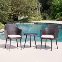 Create an intimate corner in your backyard with this charming chat set. Made from highest-quality wicker over an iron construction and the legs of the table and chairs feature a heat-transferred wood over metal and meaning that they will continue to look good whatever the weather brings. A perfect place for 2 people to enjoy the outdoors together.