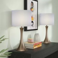 Boost brightness in your home while doubling down on sleek style with this pair of table lamps! Crafted from metal, each features a tapered base, exhibiting streamlined curves that are the hallmark of modern designs. A white linen fabric drum shade up top completes the look as it casts the glow of a 100 W bulb (not included) throughout your abode, lighting up the reading nook or illumination of the living room.
