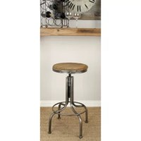 Industrial style metal bar stool with a round, natural wood seat. The natural wood grain and light beige and brown hues in the Chinese fir wood seat above the neutral, metallic gray counter stool frame are neutral enough to work with any color palette. The frame and legs have a curved base silhouette with a metal circle for a footrest. Exposed metal studs around the seat and metal threading throughout the adjustable body add functional industrial style. This wood and metal counter stool makes a...