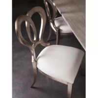 Solid mahogany frame with a warm silver leaf finish. The Signature Designs Linen Upholstered Queen Anne Back Side Chair in Warm Silver Leaf has an upholstered seat in a linen weave with a soft hand.