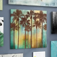 Imagine yourself lying on the beach of some tropical island, feeling the warm sand against your back as you gaze up at the slowly setting sun. To bring the beauty of that moment into your home, try hanging this lovely graphic art print. It showcases tall, thin palm trees with arching fronds set in front of a green and yellow sunset-inspired backdrop. Try hanging this canvas print in your dining room for serene, seaside style, and to craft a charming setting for every meal from Caribbean-theme...