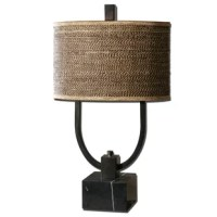 After a spirited snow-shoeing session or a long day of skiing, nothing feels better than luxuriating in a warm and relaxing glow. Brighten your abode while also adding the charm of a mountain lodge with this rustic table lamp. Crafted of metal, the base offers up a block foundation with two carving arms sprouting upward. Sure to evoke the woodsy allure of a green forest, its round wood drum shade is wrapped in brown-toned rattan for added texture. Let it sit solo atop a clean-lined wood end...