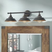 Set a spotlight on your living room seating group or kitchen ensemble with this essential wall fixture, the perfect piece for aesthetics both traditional and today. Featuring a simple metal design awash in an oil-rubbed bronze finish, this striking wall fixture offers up a touch of understated and neutral appeal to your look, while its tapered shades let the LED bulbs shine in radiant style. Set one over your master suite vanity to shine a light as you go through your morning (or evening)...