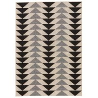 This on-trend indoor and outdoor area rug presents an eye-catching geometric pattern to high-traffic living spaces and patios alike. Black, cream and gray triangles recall striking modern designs, making a bold statement on an off-white backdrop.