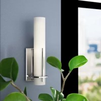 With its clean-lined silhouette and sleek chrome finish, this one-light LED wall sconce brings a touch of contemporary style to any room in your home. This stainless steel fixture features a rectangular backplate and a single vertical rod in front of its light. A cylindrical white glass shade rounds out the design, diffusing its light throughout your space. Because this piece is rated for damp locations, it's perfect for boosting the brightness in your bathroom.