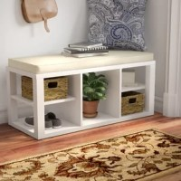 Are you stepping on your shoes more often than you're stepping into them? It may be time for a storage solution. This bench adds organization and style, making it a must-have for a den or busy entryway. Crafted from particleboard, it strikes a clean-lined silhouette, offering five compartments in which to organize your favorite shoes, bags, baskets, and beyond. An upholstered seat up top offers guests a convenient place to rest as they take off (and put on) their boots.