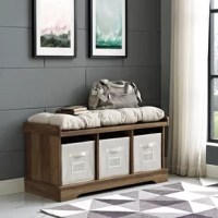 Instantly organize your mudroom or foyer with this charming storage bench. This dapper design strikes a chunky rectangular silhouette with simple moldings and classic bracket feet. Three spacious cubbies offer plenty of storage space, and three fabric storage baskets are included for all your out-the-door essentials. Rounding out the design, a thick, button-tufted cushion offers a comfy place to sit and put on your shoes before jetting out the door.