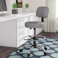 A contemporary update on a classic design, this dapper drafting lab stool is an excellent addition to your home office ensemble. The swivel seat and ergonomic backrest are cushioned with foam fill and draped in vinyl faux leather upholstery for easy cleanup and effortless maintenance, while a fixed footrest ring offers added comfort. A metal and pneumatic gas column effortlessly adjust your seat height with the assistance of a conveniently-placed lever, while the chrome five-point base comes...