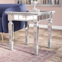 Outfit your living room, bedroom, or office in glamorous style with this square end table. Showcasing a beveled mirror tabletop and mirrored tiles on its legs and apron, this tasteful accent brings subtle shimmer to any arrangement. This compact 24