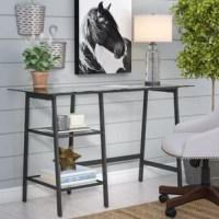 Short on square footage but eager to make the most of your spare space? Anchor your room with this on-trend and compact writing desk. This understated design is crafted with a powder-coated iron frame finished in black with open sides to ensure it won't overwhelm your arrangement. Its rectangular tempered glass top provides space to set down a laptop and a cluster of framed photos, while two lower tiers offer a spot for essential office supplies. Assembly is required.