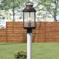 Illuminating your outdoor ensemble? Whether it's for a festive fete out on the back deck or just a little glow while you let Fido out before bed, you're sure to be smiling with this pleasant post light. Taking design inspiration from traditional lanterns, it features a metal frame finished in weathered zinc for versatile appeal. In the center, you'll find a single light that shines through the ribbed and seeded glass shade. Though certainly ready to play into coastal and nautical aesthetics for...