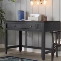 Pairing understated design with versatile style, this birch wood writing desk is a handsomee addition to your favorite aesthetic. Its molded details add a dash of dimension to your decor, while its open design brings breezy flair to any space. Play up this piece's influences by adding it to a tropical home office alongside a complementing desk chair for a cohesive look. Dot nearby walls with beach-chic canvas prints and bamboo accents for an eye-catching display, then top off the desk with a...