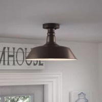 A blend of understated appeal and timeless looks, this semi-flush mount is the perfect examples of