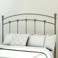 A simple design with a touch of traditional flair, this understated headboard lends a dash of breezy style to your space. Featuring an openwork, slatted design, this iron headboard is perfectly placed in front of busy wallpaper. Let tonal paisley or floral designs show through, or simply paint your walls a neutral beige or gray hue to complement this design's ash black finish. Featuring subtle scalloped details, this design pairs perfectly with textured bedding and accents around the room. Set...