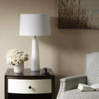 Illuminate your space with the transitional style of table lamp. Complemented by a white cone-shaped shade, this gorgeous table lamp is made from alabaster and features a chrome metal finish, for an elegant look. A 72-inch clear cord provides plenty of lengths to incorporate the lamp into your décor, while a switch on the socket makes it easy to turn the light on and off. Simple and elegant, this alabaster table lamp introduces a chic one-of-a-kind style to your home. One spiral CFL light bulb...