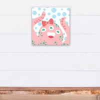 The Alamo 'Cute Bow Sea Monster' Canvas Art features the cutest pink sea monster you ever did see on a blue bubbles background to help you create a coastal look for your child's space. Each piece of artwork comes with beautiful corners a hard black backer board and hinged sawtooth hangers. The effect is a high-quality product you can be proud to showcase in your home.
