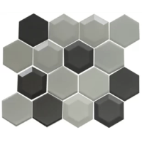 A combination of hexagon shaped tiles in white, silver, gray, and black with frosted and pearlescent finishes come together to create this three-dimensional mosaic design. These tiles are 8mm thick. Enjoy this gorgeous blend of tiles in your kitchen, bathroom or anywhere!