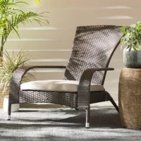 Bring contemporary style to your patio or porch with this updated chair! Founded on a tubular steel frame, this design strikes a streamlined chair silhouette wrapped in tightly-woven all-weather wicker in a rich mocha finish. Featuring a high back and fixed arms, the deep seat is lined with a polyester-blend cushion for added comfort and support.