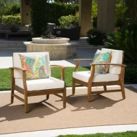 Enjoy poolside sips, kick back for a chat with a close friend, or simply enjoy the weather with this charming pair of club chairs! Crafted from acacia wood, this design's streamlined silhouette is weather- and water-resistant, so it won't flinch at the thought of constant sun or a bit of inclement weather. Cushions wrapped in polyester blend upholstery complete the look while offering comfort, encouraging you to sit and stay a while.