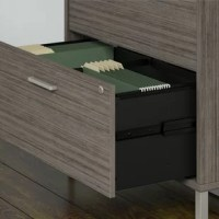 Embrace the unique styling of mid-century modern design and enjoy ample storage with the Desi 2 Drawer Lateral Filing Cabinet with Hutch. The 2 drawer cabinet offers a beautiful and durable metal base along with titanium finished hardware. Constructed of 100% thermally fused laminate, the filing cabinet fends off scratches and stains to maintain the attractive design. Organize your most important paperwork in the full-extension file drawers, which open effortlessly on smooth ball-bearing...