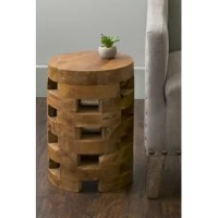 Enhance the feel of your living space with the look of natural wood beautifully stacked in this open slat wooden end table. Made from teak wood by hand, each piece is going to have natural variations in the wood tone and natural cracks. Slightly rustic, this piece looks natural and organic and will add interest to your space with its unique design.