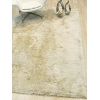 These rugs are hand-tufted with enhanced polyester for exceptional sheen and softness underfoot. Modern and versatile at the same time, this Hand-Woven Ivory Area Rug is easy to decorate with and a bold statement for your floor.
