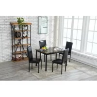 This Andreana 5 Piece Dining Set is a great option for any dining room or kitchen. The upholstered seats complemented by the faux marble table top, these sets are a stylish and convenient option for any home.