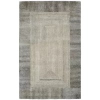 With a blend of viscose and wool, this Ernesto Hand-Woven Wool Gray Indoor Area Rug brings a natural richness and sheen to modern design. The mostly viscose pile creates a silken finish and soft luster intriguing from end to end. The tonal neutral color palette plays with a light on its surface for a luxurious look. From modern abstract designs to simple borders, this rug adds a sophisticated natural softness and textural depth to any space. There may be some fiber loss in installation, usage...