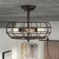 A new twist on bold industrial style, this semi flush mount illuminates your space with factory chic appeal. Constructed out of metal, this charming design showcases a pinched dome canopy with a straight down rod, while a wire cage shade ensconces the sideways bent three-light fixture for a stylish swirling look. Added dose of vintage character, this piece looks right at home shining incandescent light on a breakfast nook in your open concept, eat-in kitchen, or brightening your master bedroom.