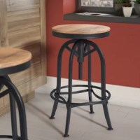 Combining quality craftsmanship with factory-chic style, this distinctive swivel bar stool anchors any space with a dash of industrial appeal. Constructed from iron in an antiqued black hue, this handsome design features four gently curved legs, a metal footrest ring, and circular foot pads. A hand-finished and distressed reclaimed pine wood seat lends the piece warmth and character, while a threaded iron shaft adjusts the seat height to suit a variety of tables and counters with a spin of the...
