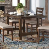Clean-lined and contemporary looks blend with rustic simplicity in this low-key dining table. Crafted from a mix of rubberwood, MDF, and poplar and acacia solids, this dining table lends an organic look to your dining room or kitchen, while the warm walnut finish brings an earthy twist to the ensemble. Distressed details let you lean into a timeworn, lived-in aesthetic in your space, while the sleek look lets you complement modern accents and furniture around the room.