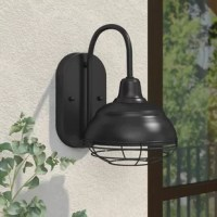 Perfect for the porch, patio, deck, garage, column, or any walled structure, this modern one-light outdoor barn light adds a touch of industrial flair to the exterior of your home. Inspired by utilitarian lights found on coastal homes and structures, this light features a simple oval backplate, a tall, curved arm, and an inverted bowl shade with a removable cage to protect against debris in the wind. Crafted from metal in a weather-resistant finish, this charming design is available in a...
