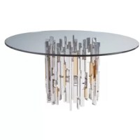 Contemporary asymmetrical designs crafted from stainless steel with certain elements electroformed with brass in a vintage coloration paired with a 60-inch Signature Designs Dining Table with Glass Top. Stainless steel and brass will show slight imperfections and polishing marks.